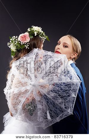 Idea of same-sex marriage. Pretty bride and groom