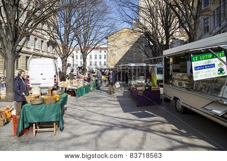 Lyon, France - February 19 2015: Local French Street Peddlers Selling Fresh Fruits And Vegetables On