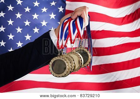 Businessman Holding Medals