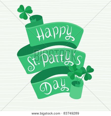 Happy St. Patty's Day lettering on a ribbon