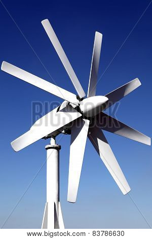 wind generator on the roof of the office. against the blue sky. Energy savings. Saving features elec