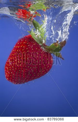 Strawberry Splashing in to Water