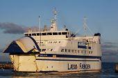 Hou, Denmark - February 5, 2015: Ferry navigating between the harbor of Hou near Odder and Samsoe island poster