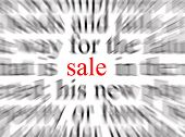Blurred text with a focus on sale poster