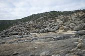 Multiple large rocks at Blowholes sight in Torndirrup National Park near Albany, Western Australia poster