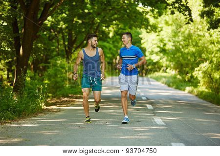 Friends Running Through Forest