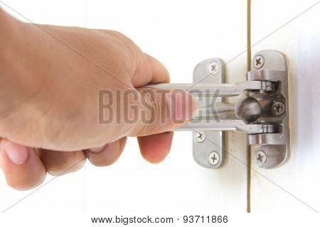 Hand On A Handle Wooden Door
