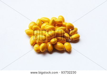 Colorful glazed Sunflower Seed candies on white background. poster