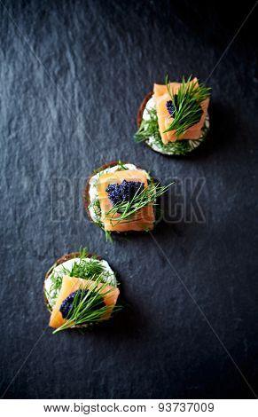 Cream cheese, smoked salmon and caviar on pumpernickel