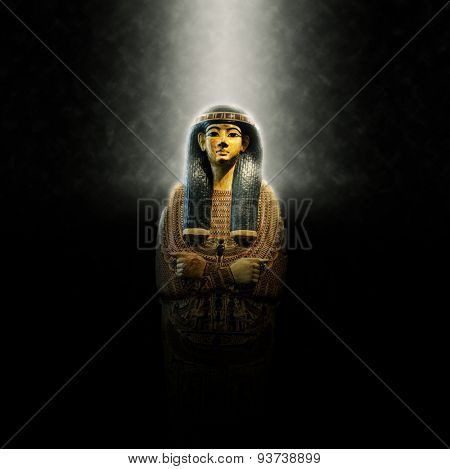 Egyptian Pharaoh Coffin, Ornate Decorative Golden Tomb of Egyptian King Lit Dramatically from Above on Dark Background