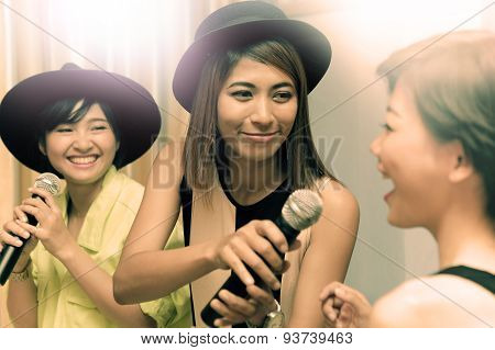 Portrait Group Of Asian Young Woman Singing A Song In Caraoke Entertainment Room  With Happiness Emo