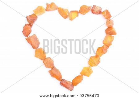 Heart of raw ambers from coast of Baltic sea isolated on white background poster