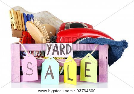 Crate of unwanted stuff ready for yard sale isolated on white