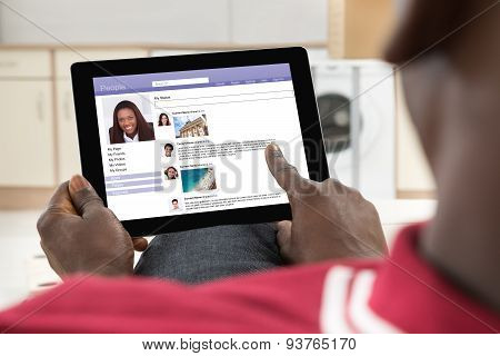 Man Chatting On Social Networking Site