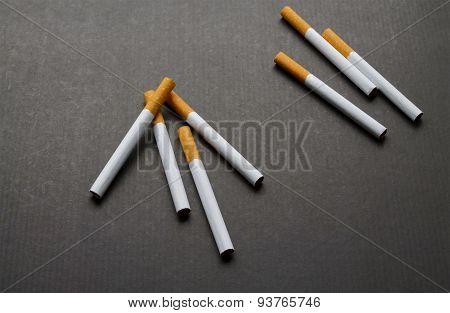 A Few Cigarets On Dark Background