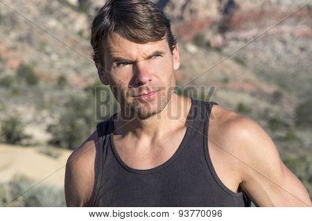 Portrait Of Adventurous Outdoorsman In The Desert