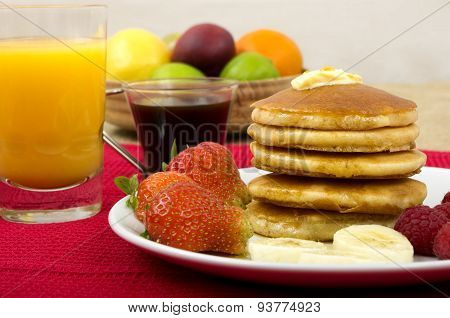 Pancakes, Maple Syrup and Fruit Breakfast