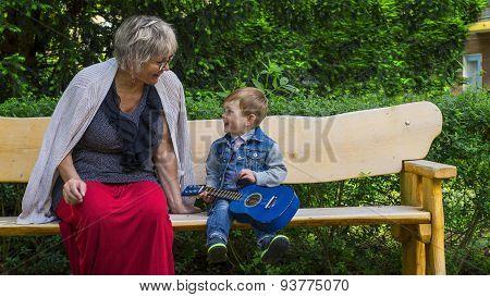 Grandmother And Grandson Singing Together