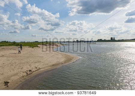 River Waal Beach And Hikers