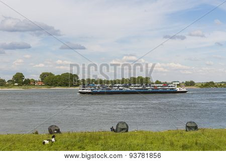 River Waal And Ship With Cars