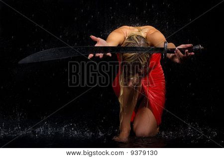 Sexual Woman Stretches Sword