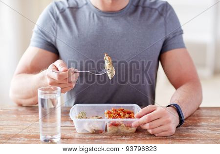 healthy eating, balanced diet, food and people concept - close up of male hands having meat and vegetables for dinner with fork and water glass poster