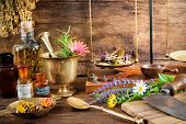 Ancient natural medicine, herbal, vials and scale on wooden background poster