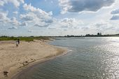 River Waal with river forelands beach and hikers The Netherlands image Daan Kloeg Commee poster
