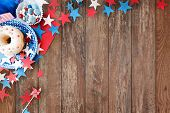 american independence day, celebration, patriotism and holidays concept - close up of glazed donut with candies in disposable tableware and stars at 4th july party from top over wooden background poster