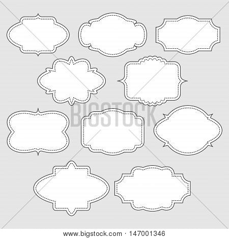 Set of white vintage labels with stitched frames