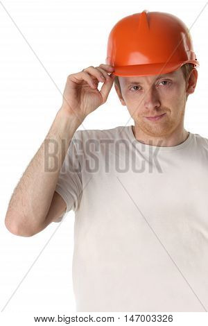 Studio portrait of a happy handyman in orange helmet