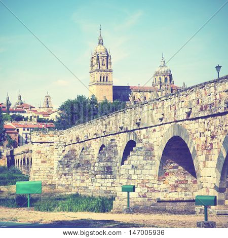 Roman bridge and Salamanca Cathedral, Castile and Leon, Spain. Instagram style filtered image