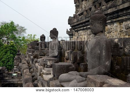 A few of the many Buddha statues at Borobudur Temple, Yogyakarta, Indonesia