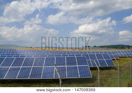 Rows of photo-voltaic in the countryside. Sunny day