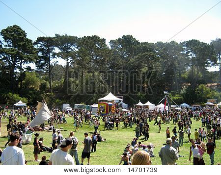 People Gather And Check Out Booths At Power To The Peaceful 2010 Music Festiva