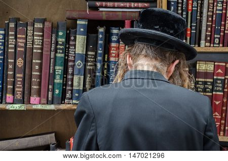Orthodox Jewish Man And Holy Books