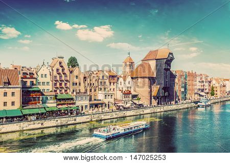 Gdansk old town and famous crane, Polish Zuraw. Motlawa river in Poland. The city also known as Danzig and the city of amber. Vintage
