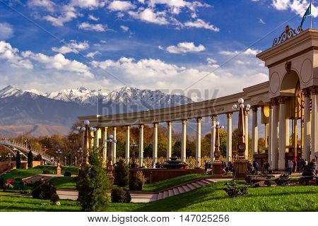 Almaty , Kazakhstan - October 27, 2014   Mountain View from the colonnade city park.   Park of the first president in Almaty - a favorite place of citizens at any time of the year. In summer it is hold festivals and holidays