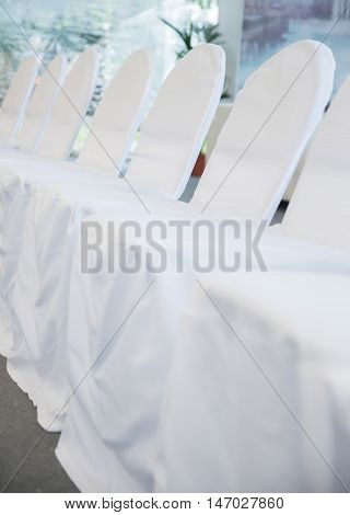 the chairs with white fabric cover for celebrations