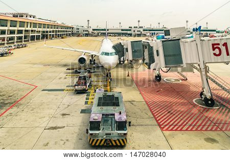 DONMUANG INTERNATIONAL AIRPORT BANGKOKTHAILAND - MAY 30 2016: Thai Smile Airways flight WE-283 load passengers and luggage before fly from Donmuang Interational Airport to Phuket Interational Airport.