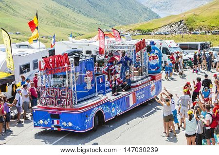 Col du Glandon France - July 23 2015: Fancy X-tra Total truck during the passing of the Publicity Caravan on Col du Glandon in Alps during the stage 18 of Le Tour de France 2015. X-tra Total is a good detergent for all fabrics produced by Henkel.