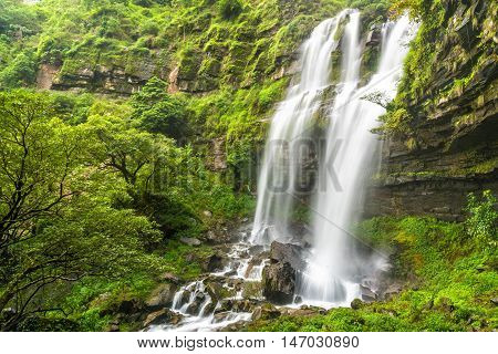 Tad TaKet waterfall A big waterfall in deep forest at Bolaven plateau Ban Nung Lung Pakse Laos.