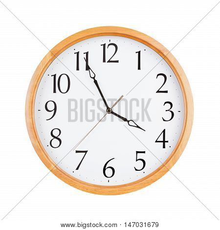 Round clock shows five minutes to four