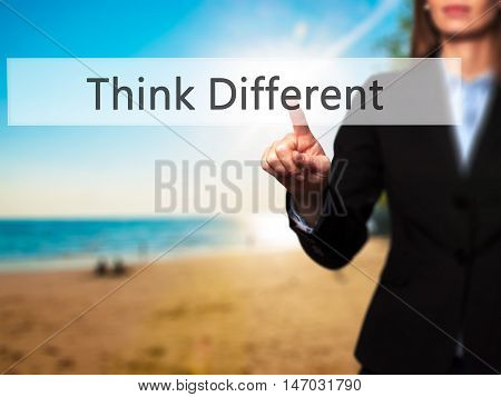Think Different - Businesswoman Pressing High Tech  Modern Button On A Virtual Background