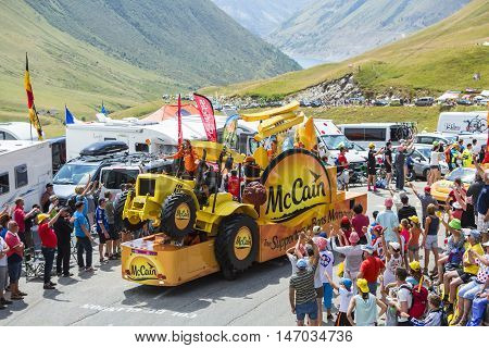 Col du Glandon France - July 23 2015: Mc Cain vehicle during the passing of the Publicity Caravan on Col du Glandon in Alps during the stage 18 of Le Tour de France 2015. Mc Cain is a market leader in frozen products made from potatoes.