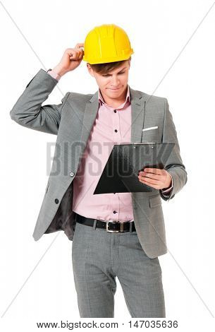 Portrait of a young architect with yellow hard hat. An engineer or foreman holding clipboard. Young construction worker or businessman wearing helmet, isolated on white background.