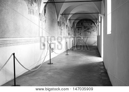 AREZZO, ITALY - AUGUST 16, 2016: old middle age colonnade of an ancient building in the historical city centre of Arezzo (Tuscany, Italy).