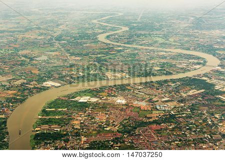 Top view of Chaopraya river and Bangkok city on haze day that capture on airplane.