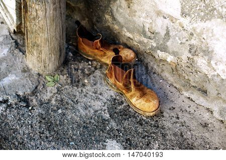Old shoes on the street concept of travel or vagrancy