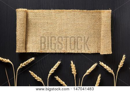 ears of wheat and cloth  on wooden background